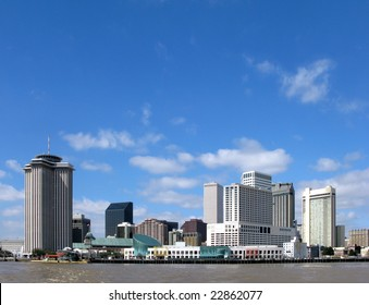 New Orleans Louisiana downtown skyline cityscape of the hotel district and commercial waterfront across the Mississippi River from Algiers on a sunny day with blue sky