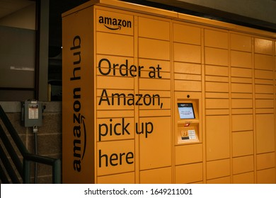 New Orleans, Louisiana - February 9, 2020: yellow Amazon locker hub for product pick up