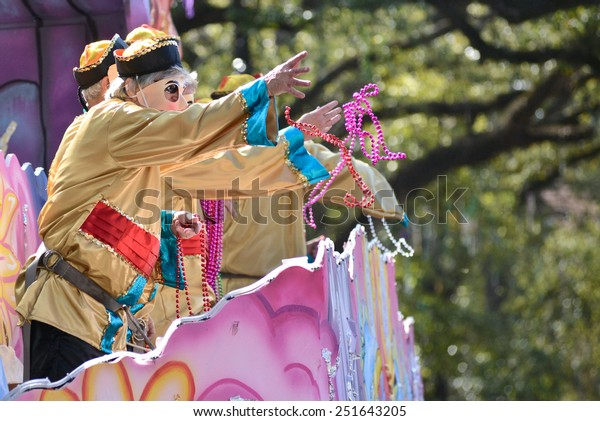 """New Orleans, Louisiana - February 9, 2015: The krewe of Carrollton parades down St. Charles Avenue for Carnival Season.  This year's theme is """"Night at the Opera""""."""