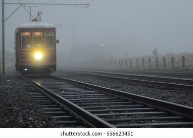 New Orleans, Louisiana = January 15, 2017- Street car in the fog in New Orleans, Louisiana.