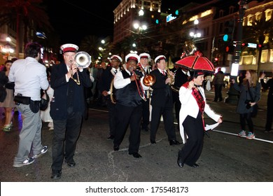 NEW ORLEANS, LOUISIANA- JANUARY 18, 2014:  Mardi Gras celebrants party on Bourbon Street in the French Quarter of New Orleans.