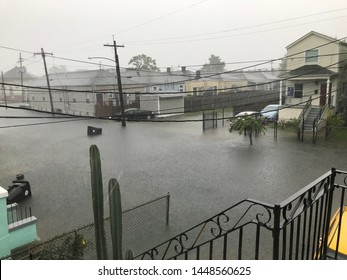 New Orleans, Louisiana - July 11, 2019: Flash Flood on the Street of New Orleans Resulting in Extensive Damage to Homes and Vehicles Before Hurricane Barry
