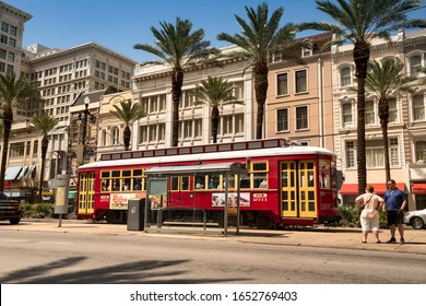 New Orleans, Louisiana - June 16, 2019:  A historic red streetcar travels down the train tracks on Canal Street in New Orleans, Louisiana USA