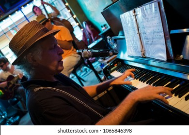 New Orleans, Louisiana - June 20, 2014: Jazz musician playing the piano at the Spotted Cat Music Club in the city of New Orleans, Louisiana, USA
