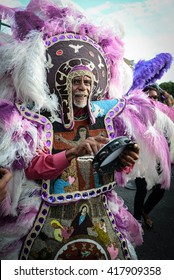 New Orleans, Louisiana; March 25, 2016:  Big Chief Alfred Doucette, a Mardi Gras Indian, marches in the Prince second line parade in New Orleans, Louisiana.