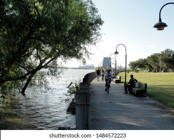 New Orleans, Louisiana - May 5, 2011: The Mississippi river nearly overtops its banks at Audubon Park in Uptown New Orleans