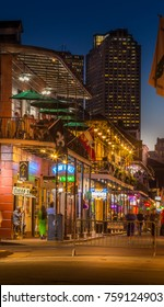 NEW ORLEANS, LOUISIANA - OCTOBER 19, 2017: Neon lights and bars in the French Quarter. Tourism provides a much needed source of revenue to the city.
