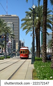 New Orleans, Louisiana - October 5, 2014: A red streetcar travels down Canal street on a sunny Sunday afternoon.