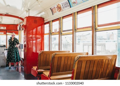 New Orleans, Louisiana / United States - June 26-2018: Mature woman in streetcar in downtown New Orleans on Canal Street.