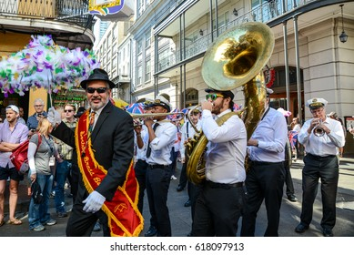New Orleans, Louisiana / USA - April 6, 2017:  A Second Line band plays for French Quarter Fest as it marches in the French Quarter in New Orleans, Louisiana.