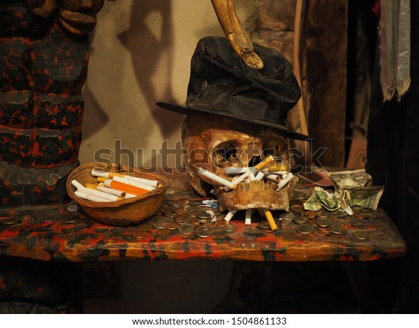 New Orleans, Louisiana / USA - August 6th, 2019: An old skeleton with a black hat in New Orleans Historic Voodoo Museum