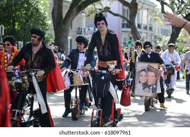 New Orleans, Louisiana / USA - February 18, 2017:  The Krewe of Rolling Elvi - Elvis impersonation group - marches down Saint Charles Avenue for a Mardi Gras parade in New Orleans, Louisiana.