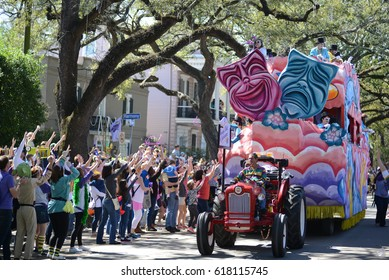 New Orleans, Louisiana / USA - February 25, 2017: A float for a Mardi Gras parade rolls down Saint Charles Avenue in New Orleans, Louisiana.
