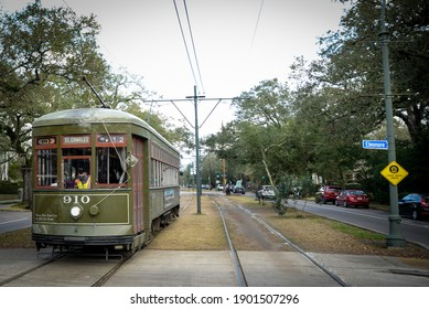 New Orleans, Louisiana  USA - January 24, 2021: A streetcar drives down St. Charles Avenue in New Orleans, Louisiana.