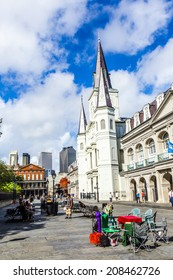 NEW ORLEANS, LOUISIANA USA - JULY 17, 2013:  St. Louis cathedral in the French Quarter in New Orleans, USA. Tourism provides a large source of revenue after the 2005 devastation of Hurricane Katrina.
