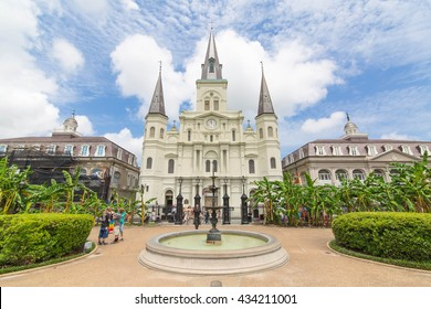 NEW ORLEANS, LOUISIANA, USA - JUNE 6, 2016: St. Louis Cathedral with Water Fountain and visiting Tourists in Jackson Square, French Quarter
