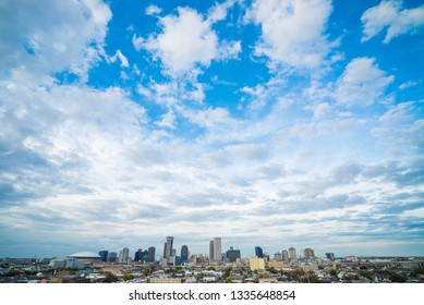 New Orleans, Louisiana / USA - March 8 2019: New Orleans city skyline from Pontchartrain Hotel rooftop on a partly cloudy day.