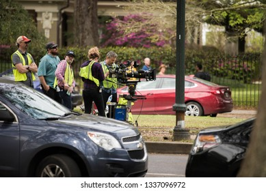 New Orleans, Louisiana / USA - March 8 2019: Behind-the-scenes shot of a film/TV crew shooting on St. Charles Avenue near the St. Charles streetcar track and Tulane University in New Orleans