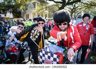 New Orleans, Louisiana / USA - March 23, 2019: The Krewe of Rolling Elvi parade down Saint Charles Avenue in the King Arthur parade in New Orleans, Louisiana during Mardi Gras Season.