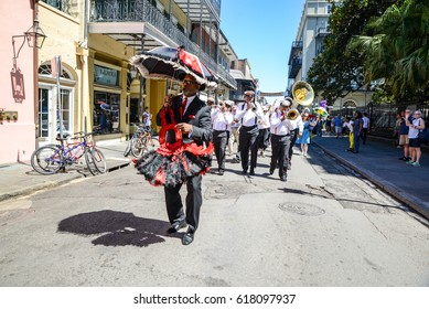 New Orleans, Louisiana / USA - March 31, 2017:  A Second Line band plays as it marches in the French Quarter in New Orleans, Louisiana.