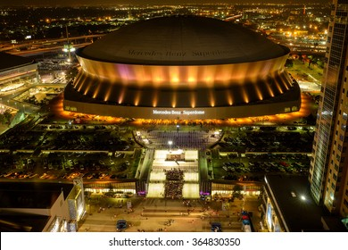 New Orleans, Louisiana, USA - October 26, 2014: On the night of the NFL Sunday Night game Green Bay Packers vs. New Orleans Saints, Mercedes-Benz Superdome is lit up by the colorful neon lights.