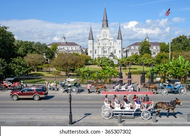 New Orleans, Louisiana, USA - October 28, 2014: The street in front of Jackson Square in French Quarter is a big attraction, often filled with traffics of horse-drawn tourist carriages and modern cars