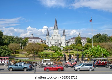 New Orleans, Louisiana, USA - October 28, 2014: As a big tourist attraction in the city, Jackson Square and its streets are often filled with tourist, horse-drawn carriages and modern cars.