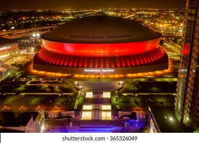 New Orleans, Louisiana, USA - October 28, 2014: At night, Mercedes-Benz Superdome, the home stadium of the New Orleans Saints football team, is lit up by the bright and colorful neon lights.