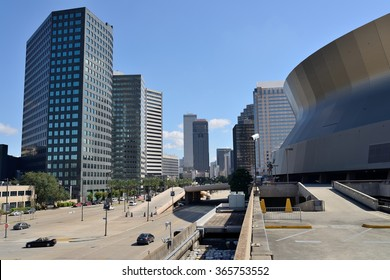New Orleans, Louisiana, USA - October 29, 2014: A mid-day street view of New Orleans' Downtown Center Business District, on the Poydras Street, next to the Superdome.