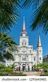 NEW ORLEANS, LOUISIANA/USA -  SEPTEMBER 01 2016: Saint Louis Cathedral in Jackson Square, New Orleans with people walking out of it, on a bright sunny day