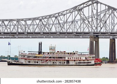 NEW ORLEANS, MISSISSIPPI, USA - MAY 26, 2015: The Natchez riverboat turning at the Crescent City Bridges on  the Mississippi River at New Orleans with tourists on board on one of its daily tours.