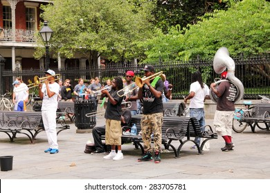 NEW ORLEANS, MISSISSIPPI, USA - MAY 26, 2015: A jazz band entertains in Jackson Square, New Orleans, collecting money from the stream of tourists taking self guided walking tours through the square.