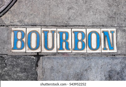 New Orleans sidewalk tiled letter sign for Bourbon Street in the French Quarter neighborhood. Vintage blue and white letters. Background for New Orleans theme.