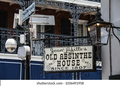 NEW ORLEANS / UNITED STATES - JULY 7, 2011: Jean Lafitte's Old Absinthe House, a landmark New Orleans watering hole established in 1807 on Bourbon Street. Beads hanging from the sign.