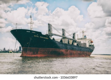 NEW ORLEANS / UNITED STATES - JULY 7, 2011: The Royal Pescadores, a bulk carrier Panamanian freighter ship on the Mississippi River near New Orleans, Louisiana.