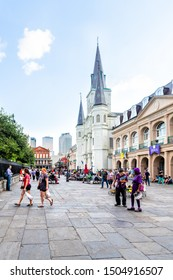 New Orleans, USA - April 22, 2018: Old town chartres street in Louisiana famous city with many people crowd at Jackson square and St Louis cathedral church