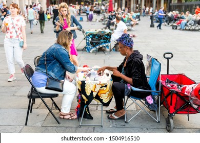 New Orleans, USA - April 22, 2018: Old town street in Louisiana city by St Louis cathedral church, many people crowd on Jackson square with tarot card reading palm woman