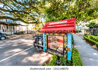 New Orleans, USA - April 23, 2018: Mini little free library bibliotheque in uptown garden district with books by sidewalk wide angle and nobody