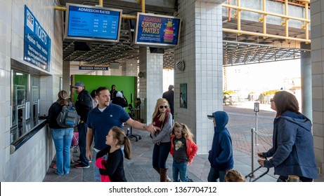 New Orleans, USA - Dec 10, 2017: At the ticket booth to the popular Audubon Aquarium of the Americas. People on a queue to purchase tickets.