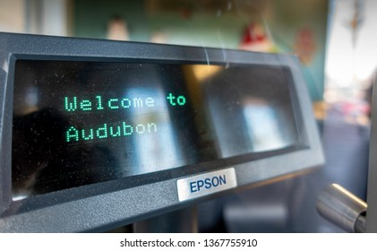 New Orleans, USA - Dec 10, 2017: Cash register at the Audubon Aquarium of the Americas. Image taken from outside the ticket booth and through a window. Some reflections can be seen.