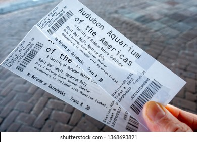 New Orleans, USA - Dec 10, 2017: Two adult tickets for entry to the popular Audubon Aquarium of the Americas at Woldenberg Park, in the city center not far away from the French Quarters.