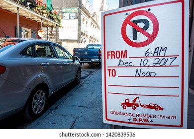 New Orleans, USA - Dec 11, 2017: Car parking limitation warning sign from 6am to noon on December 10th. A vehicle tow-away zone in accordance to the local council ordinance.