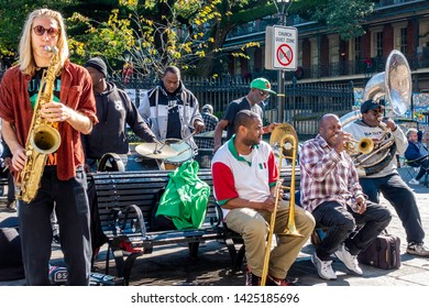 New Orleans, USA - Dec 11, 2017: A group of street musicians performing a lively jazz act to entertain the passing public. Image captured at the iconic French Quarter, in front of Jackson Square.