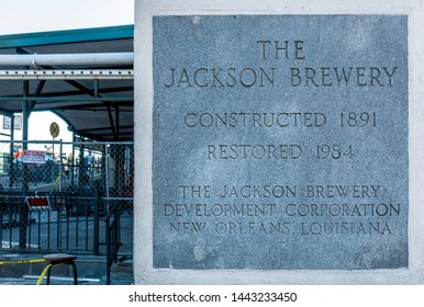 New Orleans, USA - Dec 11, 2017: A granite commemorative plaque to the iconic Jackson Brewery Company sits along Decatur Street, in the French Quarter.