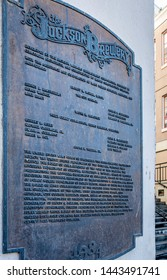 New Orleans, USA - Dec 11, 2017: A bronze commemorative plaque to the iconic Jackson Brewery Company sits along Decatur Street, in the French Quarter.