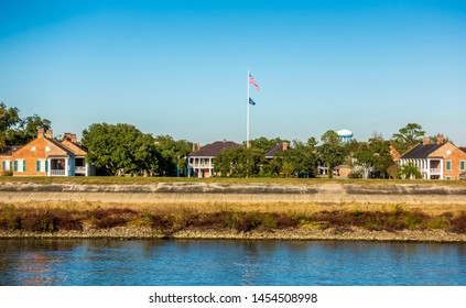 New Orleans, USA - Dec 11, 2017: Compound of the United States Army National Guard, as viewed from the Mississippi River. A national flag stands in the middle of the image.