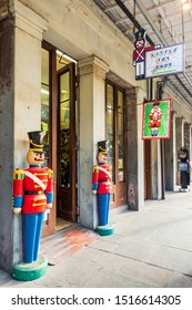 New Orleans, USA - Dec 17, 2017: Life-size soldier statues stand guard in front of the Little Toy Shop along St. Ann Street in the French Quarter. This street runs beside the iconic Jackson Square.