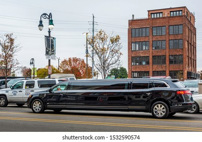 New Orleans, USA - Dec 17, 2017: A black stretch limousine driving through the traffic along Decatur Street at the iconic French Quarter.