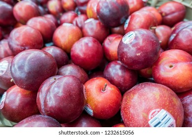 New Orleans, USA - Dec 3, 2017: Harvested ripe plums displayed for sale at a local fruit grocer.