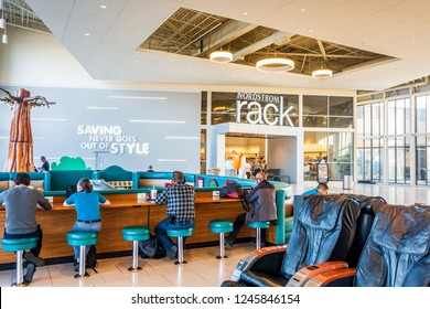 New Orleans, USA - Dec 4, 2017: Spacious interior of the Outlet Collection at Riverwalk. In front of Nordstrom Rack store is a common area for the patrons to relax.